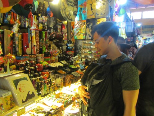 Taking a close look at the souvenirs sold at this shop