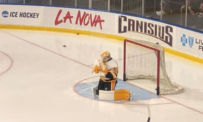 Emil Larmi makes a save during warmups. Photo by Dan Kingerski. All Rights Reserved.