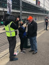 Pittsburgh's Chip Ganassi is interviewed on pit road by IMS' Katie Kiel