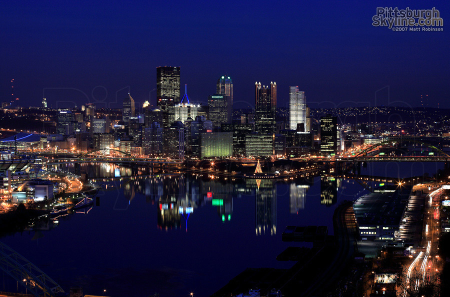 Three still rivers reflect the city of Pittsburgh