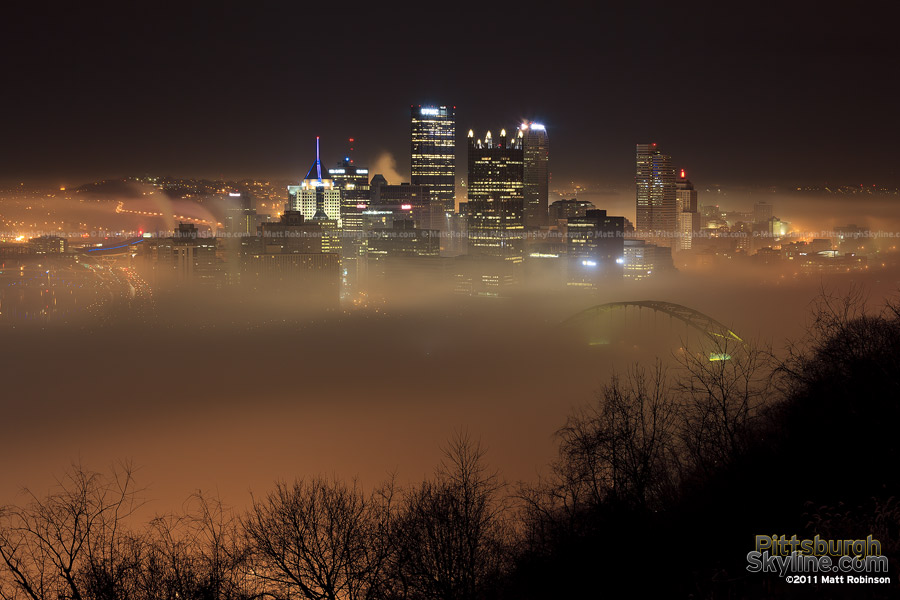 River fog obscures parts of downtown Pittsburgh skyline