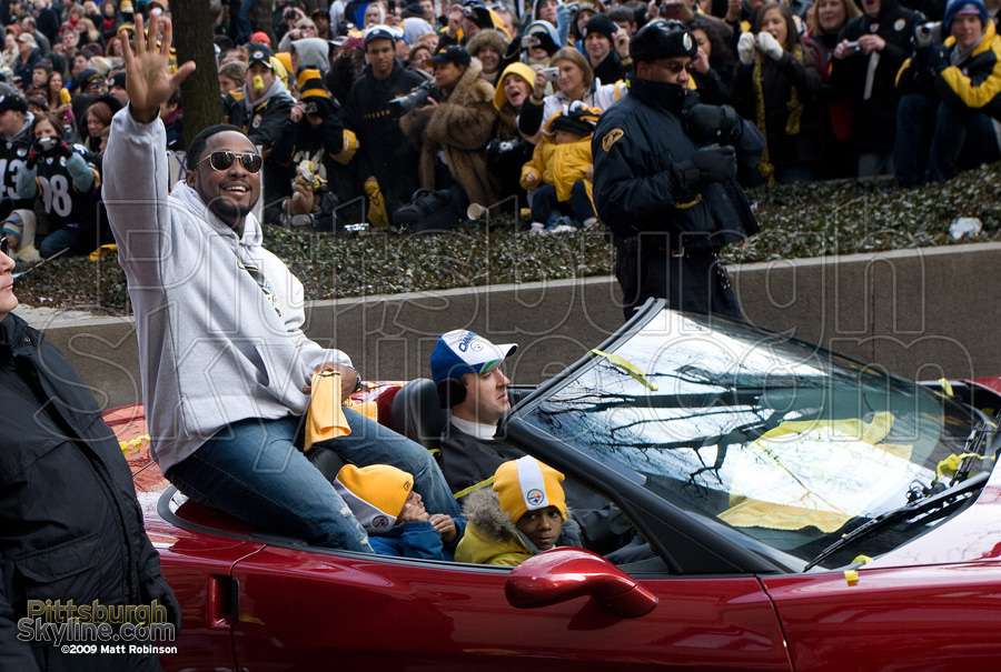 Pittsburgh Steelers head coach Mike Tomlin waves to the crowd.