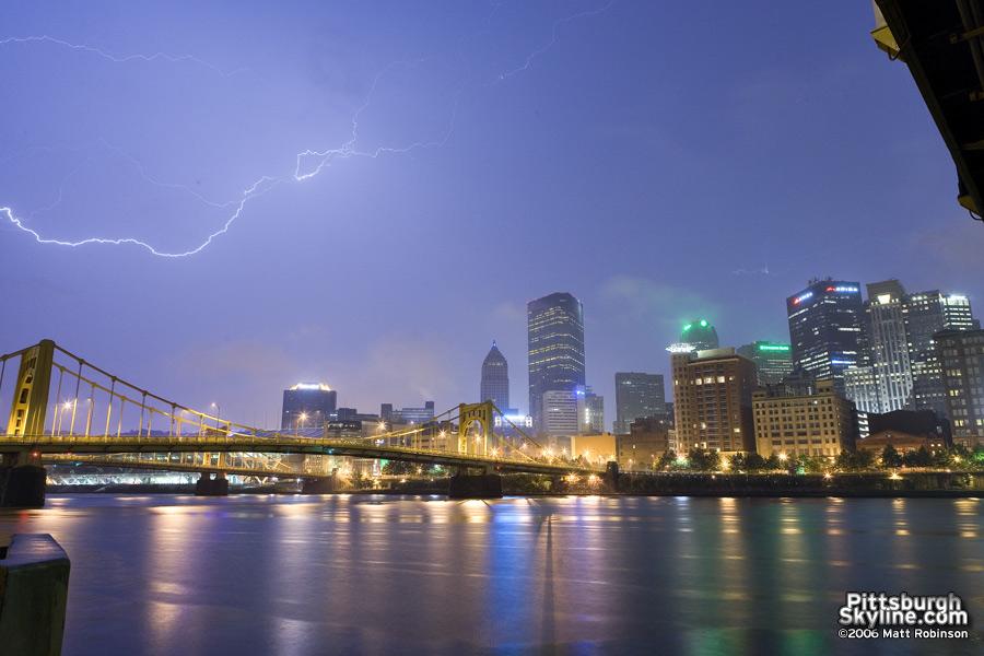 Lightning streaks across the sky from the North Shore