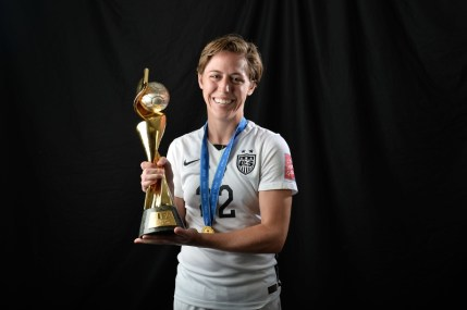 Megan Klingenberg with the World Cup trophy...