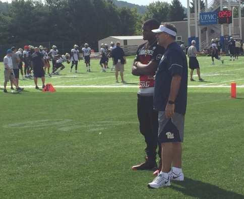 Donovan Jeter chats with Pat Narduzzi (Photo credit: Alan Saunders)