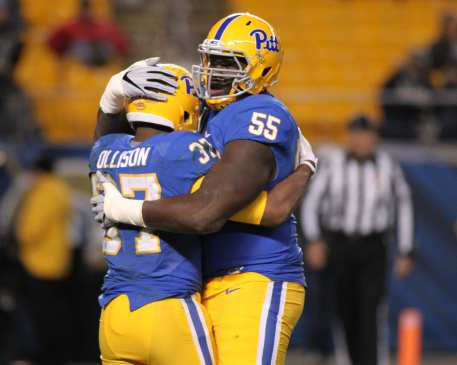 Jaryd Jones-Smith hugs Qadree Allison after his touchdown run on November 19, 2016 (Photo by: David Hague)