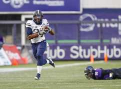 Qadree Ollison #37 of the Pittsburgh Panthers runs after the catch as Nate Hall #32 of the Northwestern Wildcats watches. The Northwestern Wildcats defeated the Pittsburgh Panthers 31-24 in the 2016 New Era Pinstripe Bowl at Yankee Stadium on Wednesday, December 28, 2016.