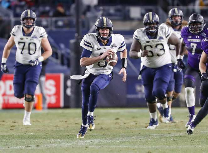 Ben DiNucci #3 of the Pittsburgh Panthers on the quarterback keeper. The Northwestern Wildcats defeated the Pittsburgh Panthers 31-24 in the 2016 New Era Pinstripe Bowl at Yankee Stadium on Wednesday, December 28, 2016.