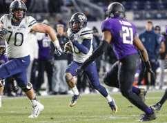 Quadree Henderson #10 of the Pittsburgh Panthers rushes the ball upfield. The Northwestern Wildcats defeated the Pittsburgh Panthers 31-24 in the 2016 New Era Pinstripe Bowl at Yankee Stadium on Wednesday, December 28, 2016.