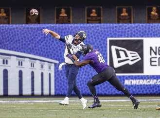 Joseph Jones #42 of the Northwestern Wildcats hits Nathan Peterman #4 of the Pittsburgh Panthers as he throws the ball. The Northwestern Wildcats defeated the Pittsburgh Panthers 31-24 in the 2016 New Era Pinstripe Bowl at Yankee Stadium on Wednesday, December 28, 2016.