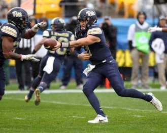 Ben DiNucci (3) hands the ball off October 28, 2017 -- David Hague