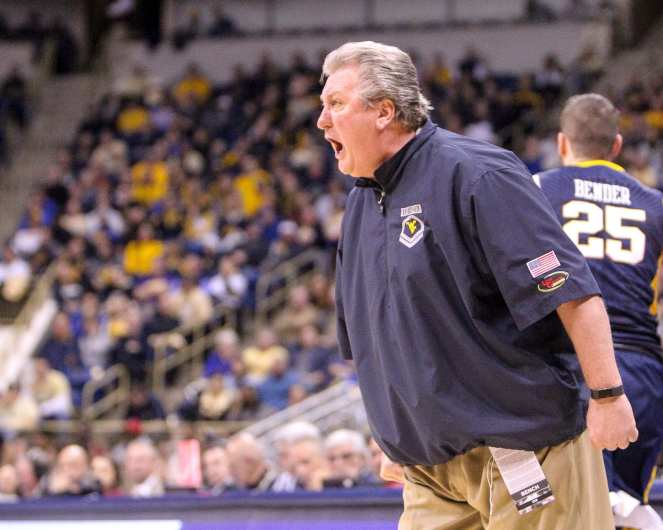 Head Coach Bob Huggins yells at his player after committing a foul as the Pitt Panthers take on West Virginia on December 9, 2017 -- DAVID HAGUE