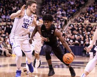 Marcus Carr (5) drives the lane against Antonio Vrankovic (30) against Duke on January 10, 2018 -- DAVID HAGUE