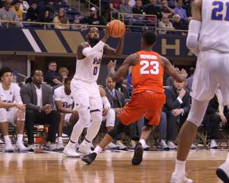 Jared Wilson-Frame (0) shoots a 3-pointer against Syracuse on January 27, 2018 -- DAVID HAGUE