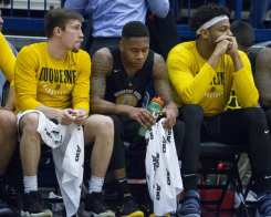 Mike Lewis II sits on the bench February 10, 2018 -- DAVID HAGUE