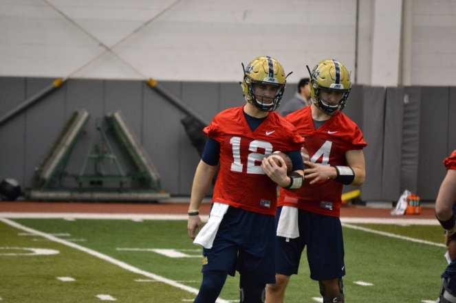 New quarterbacks Ricky Town (12) and Tyler Zelinski (14).