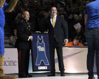 Head Coach Keith Gavin presents Major General Daniel J. Lecce a framed singlet December 15, 2018 -- David Hague/PSN