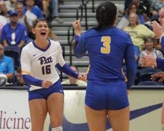 Angela Seman (16) celebrates a point October 5, 2018 -- DAVID HAGUE