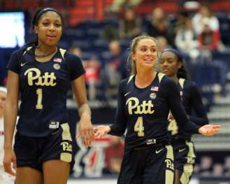 Cassidy Walsh (4) and Danielle Garven (1) all smiles after beating Duquesne December 29, 2018 -- David Hague/PSN