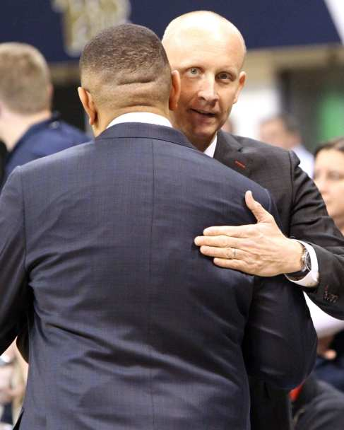 Jeff Capel and Chris Mack greet each other before game on January 9, 2019 -- David Hague/PSN
