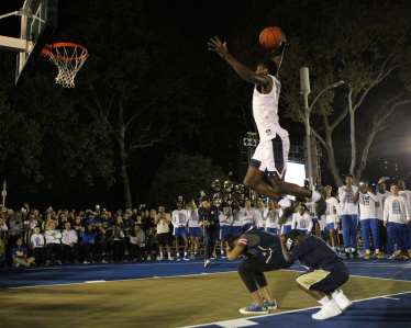 Xavier Johnson (7) tries to dunk over 2 kids at Courtside by the Cathedral October 5, 2018 -- DAVID HAGUE