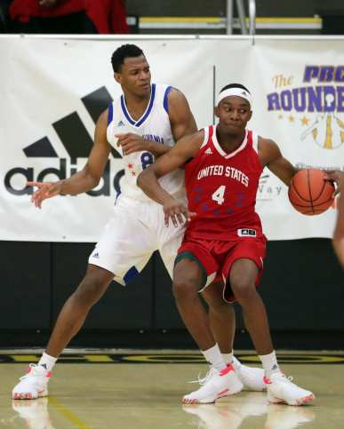 Karim Coulibaly (8) and Jaelyn Withers (4) in the PBC Roundball Classic April 28, 2019 -- David Hague/PSN