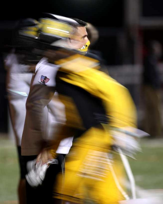 Art Walker high-fives his players as they run off the field November 7, 2020 David Hague/PSN