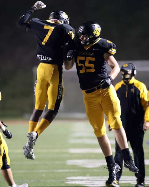Kolin Dinkins (7) celebrates his interception with Brian Caputo (55) November 7, 2020 David Hague/PSN