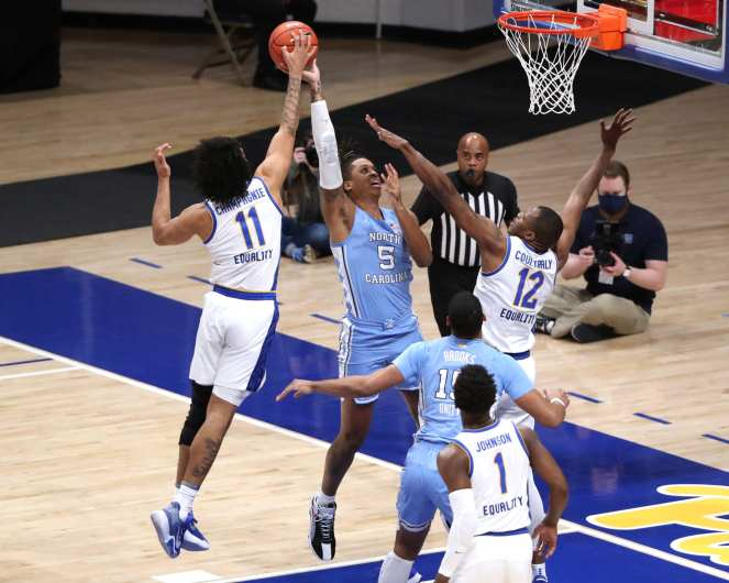 Justin Champagnie (11) with the block on Armando Bacot (5) January 26, 2021 Photo by David Hague/PSN