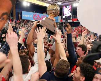 RMU celebrates with the students after winning the NEC March 10, 2020 -- David Hague/PSN