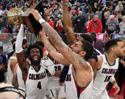 Jalen Hawkins (4) celebrates with the team March 10, 2020 -- David Hague/PSN