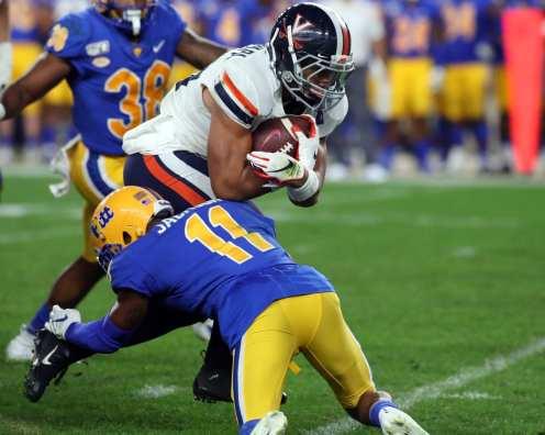 Dane Jackson (11) tackles Wayne Taulapapa (21) -- August 31, 2019 Photo By David Hague/PSN