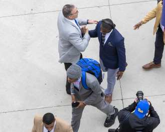 Pat Narduzzi greets players as they enter Heinz Field November 30, 2019 -- David Hague/PSN