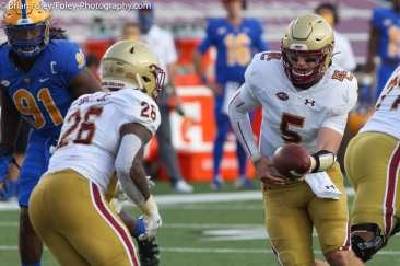 Oct. 10, 2020; Chestnut Hill, Massachusetts, USA; Boston College Eagles quarterback Phil Jurkovec (5) hands a ball off during an ACC matchup between Pittsburgh and Boston College. The Eagles won the game 31-30 in overtime over the Panthers. Credit © Brian Foley for Foley-Photography.