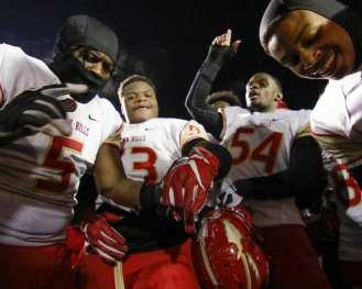 Penn Hills players react after winning November 23, 2018 — BEN BAMFORD