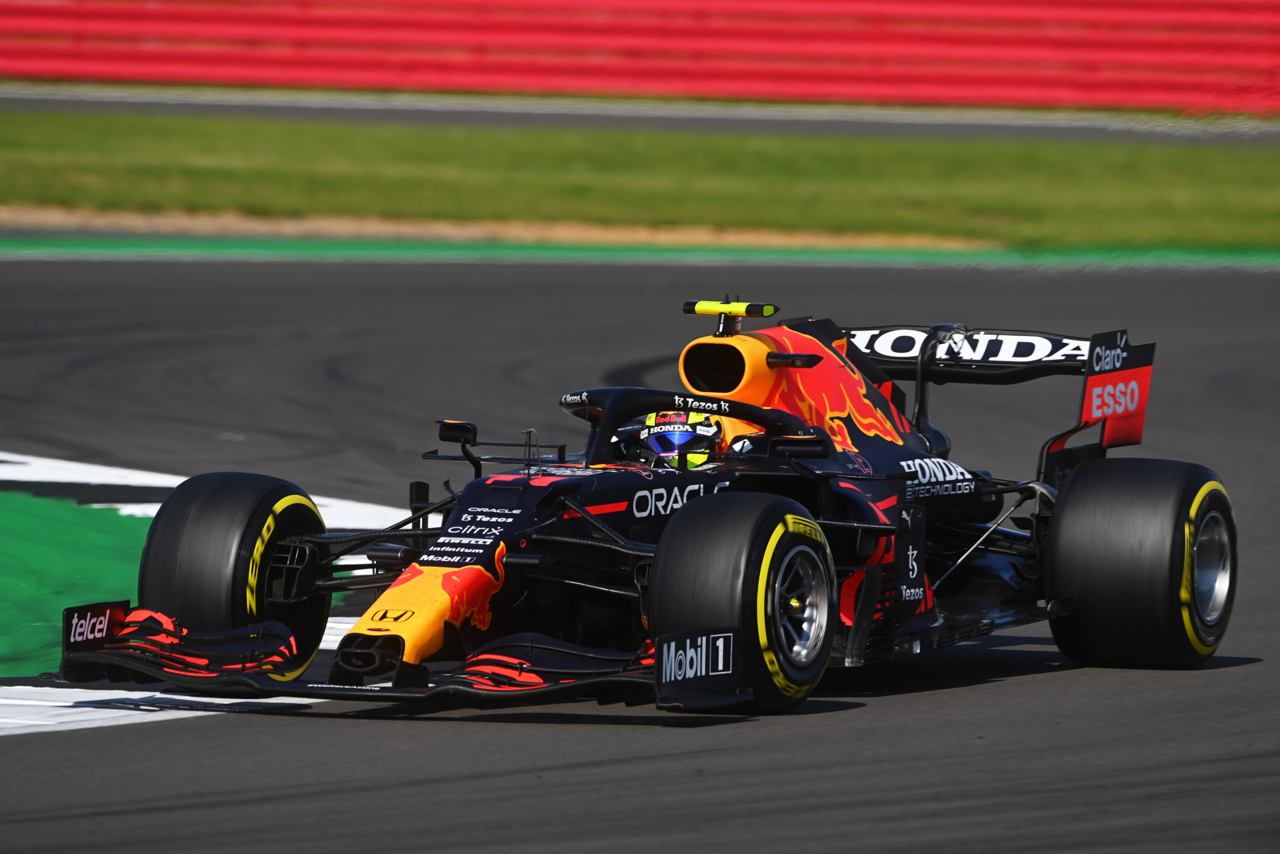 NORTHAMPTON, ENGLAND - JULY 18: Sergio Perez of Mexico driving the (11) Red Bull Racing RB16B Honda during the F1 Grand Prix of Great Britain at Silverstone on July 18, 2021 in Northampton, England. (Photo by Michael Regan/Getty Images) // Getty Images / Red Bull Content Pool  // SI202107180270 // Usage for editorial use only //