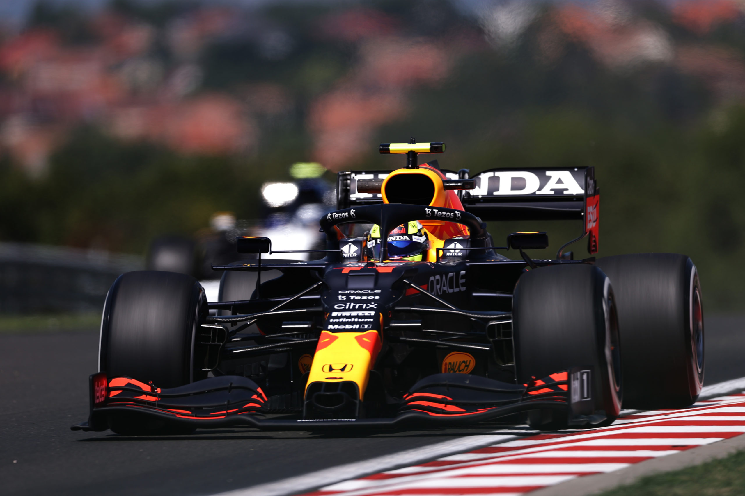 BUDAPEST, HUNGARY - JULY 30: Sergio Perez of Mexico driving the (11) Red Bull Racing RB16B Honda during practice ahead of the F1 Grand Prix of Hungary at Hungaroring on July 30, 2021 in Budapest, Hungary. (Photo by Lars Baron/Getty Images) // Getty Images / Red Bull Content Pool  // SI202107300139 // Usage for editorial use only //