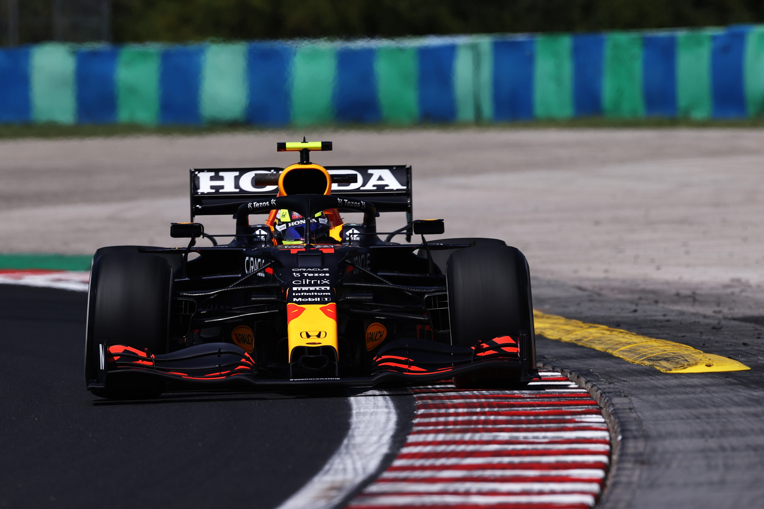 BUDAPEST, HUNGARY - JULY 30: Sergio Perez of Mexico driving the (11) Red Bull Racing RB16B Honda during practice ahead of the F1 Grand Prix of Hungary at Hungaroring on July 30, 2021 in Budapest, Hungary. (Photo by Lars Baron/Getty Images) // Getty Images / Red Bull Content Pool  // SI202107300173 // Usage for editorial use only //