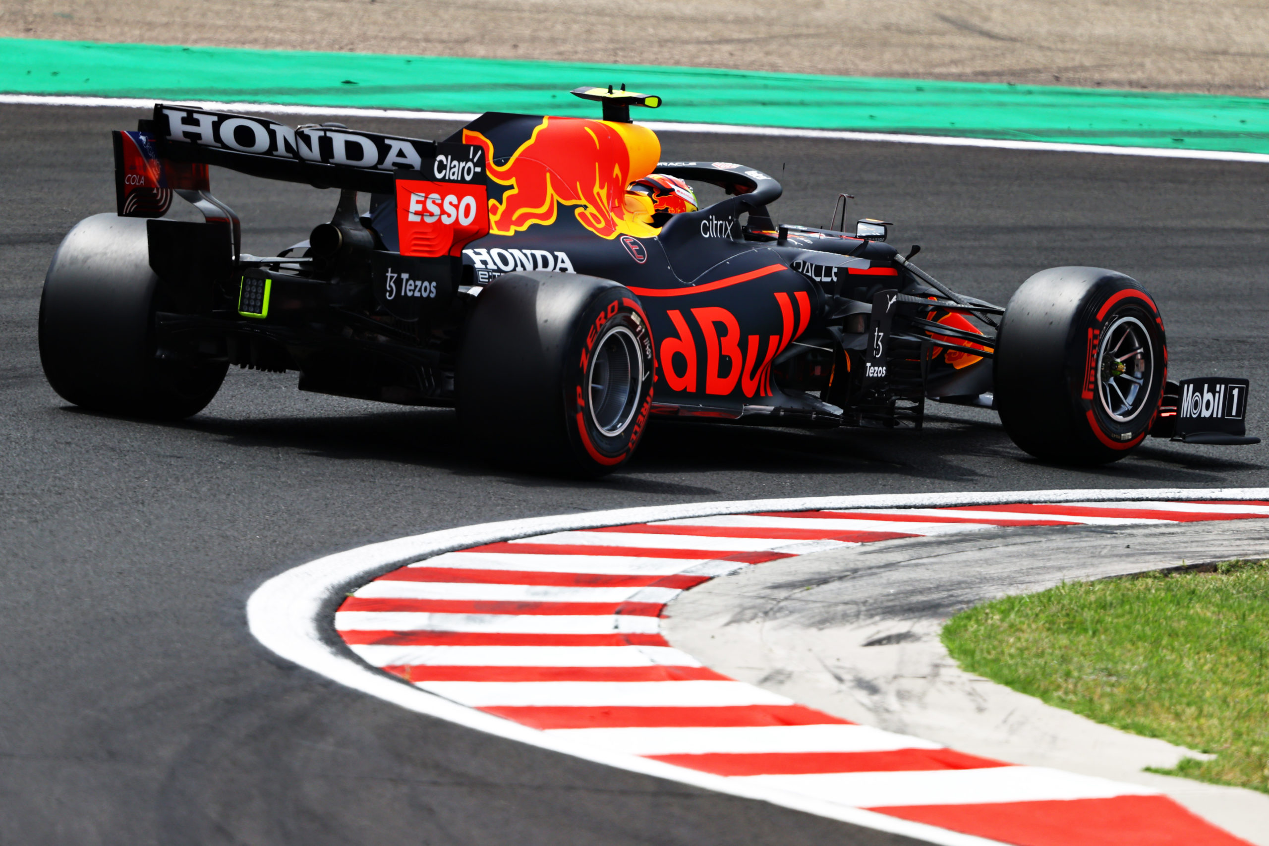 BUDAPEST, HUNGARY - JULY 31: Sergio Perez of Mexico driving the (11) Red Bull Racing RB16B Honda during final practice ahead of the F1 Grand Prix of Hungary at Hungaroring on July 31, 2021 in Budapest, Hungary. (Photo by Bryn Lennon/Getty Images) // Getty Images / Red Bull Content Pool  // SI202107310214 // Usage for editorial use only //
