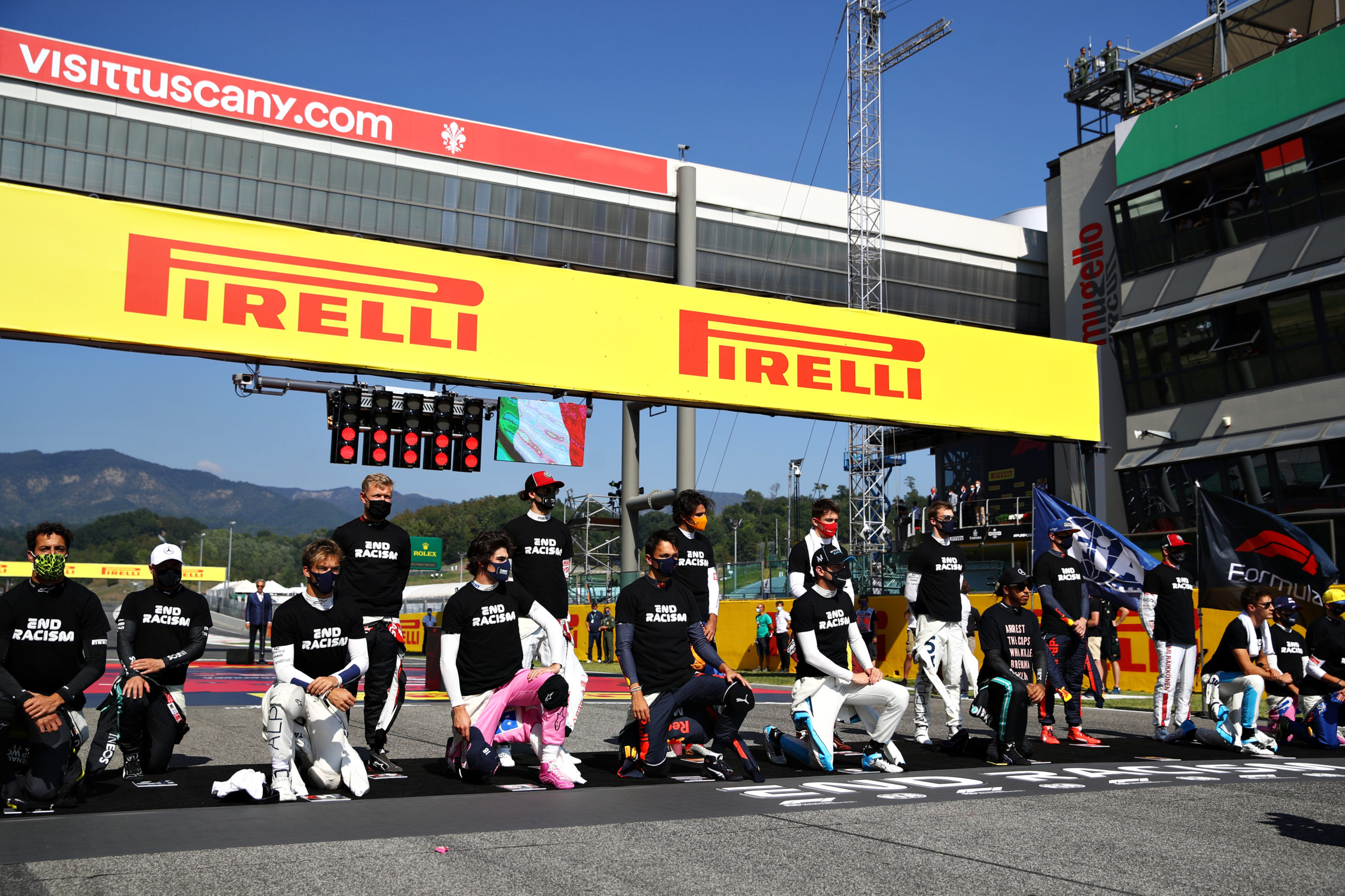 SCARPERIA, ITALY - SEPTEMBER 13: F1 drivers including Pierre Gasly of France and Scuderia AlphaTauri and Alexander Albon of Thailand and Red Bull Racing stand and kneel on the grid in support of ending racism before the F1 Grand Prix of Tuscany at Mugello Circuit on September 13, 2020 in Scarperia, Italy. (Photo by Mark Thompson/Getty Images) // Getty Images / Red Bull Content Pool  // SI202009130169 // Usage for editorial use only //
