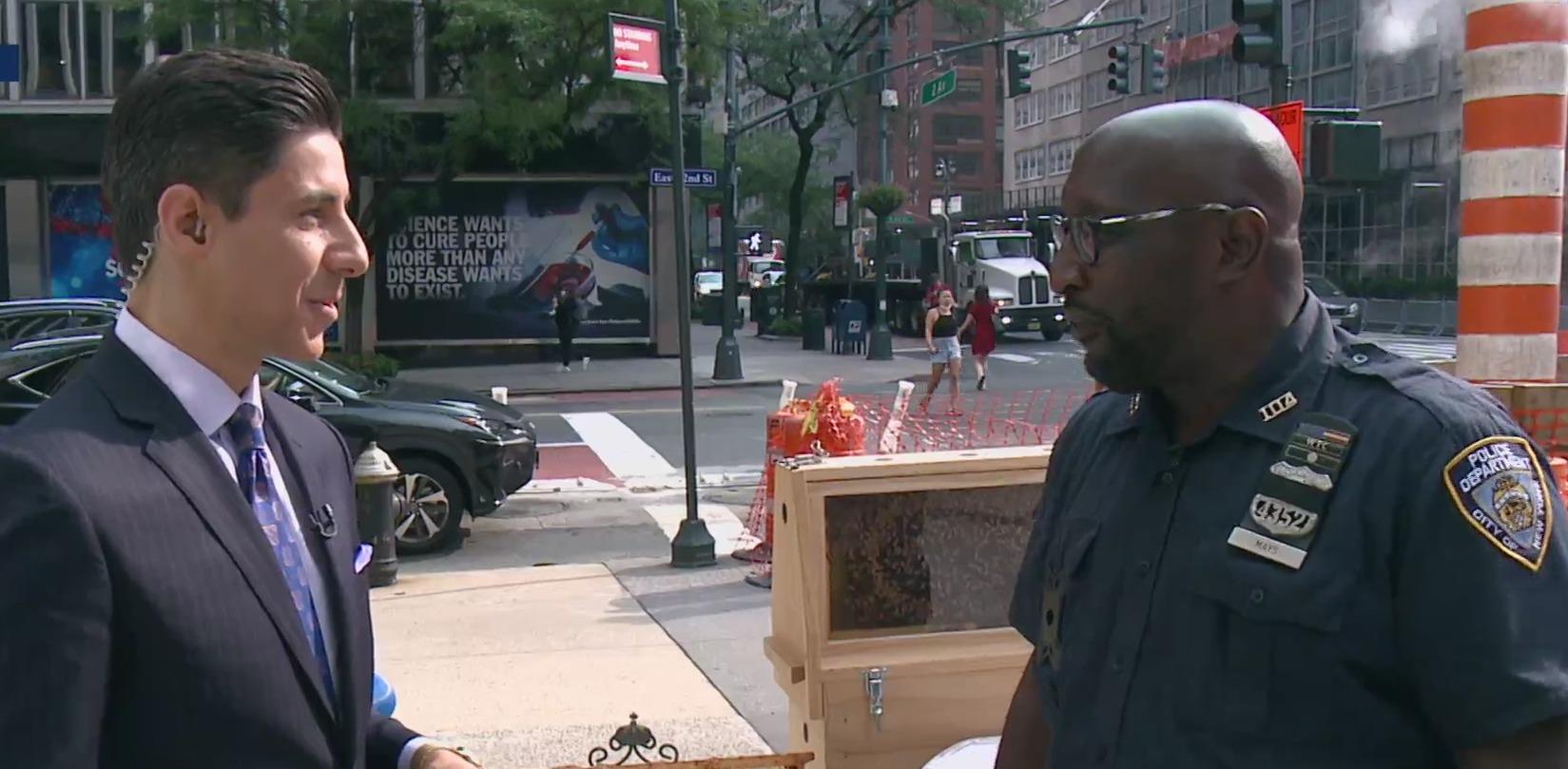 NYPD beekeeper Officer Darren Mays and PIX11's Dan Mannarino