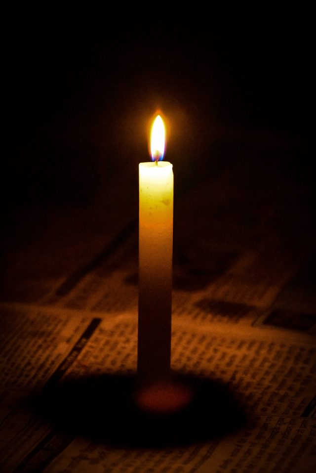 A Standing Lighted Candle
