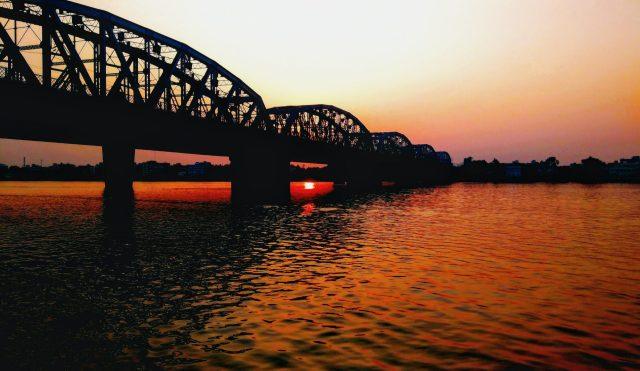 Arch Bridge on the River Sunset