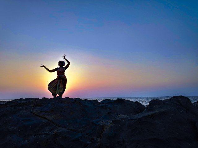 girl dancing at the seaside