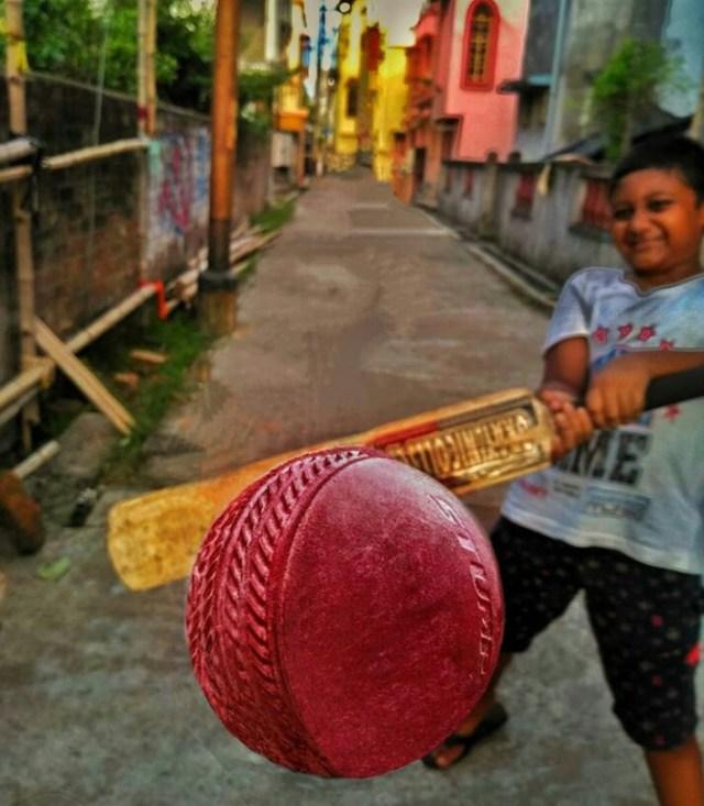 Boy playing Galli cricket