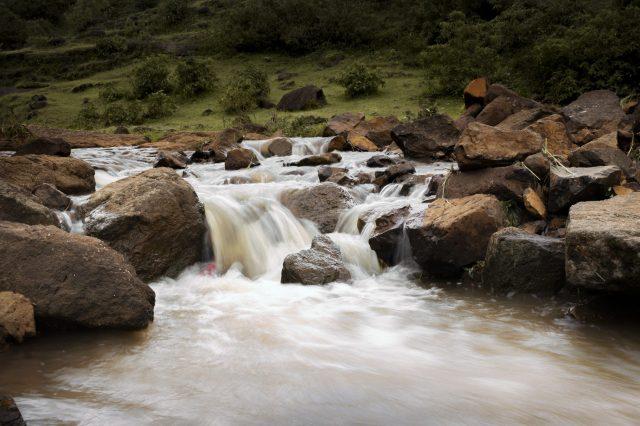 Stream running through a valley.