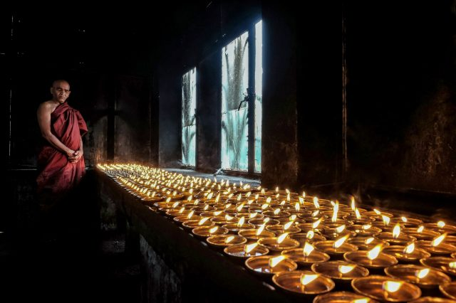 Oil lamps in a Buddha Temple