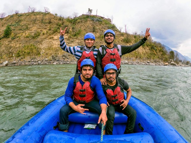 Men Water Rafting