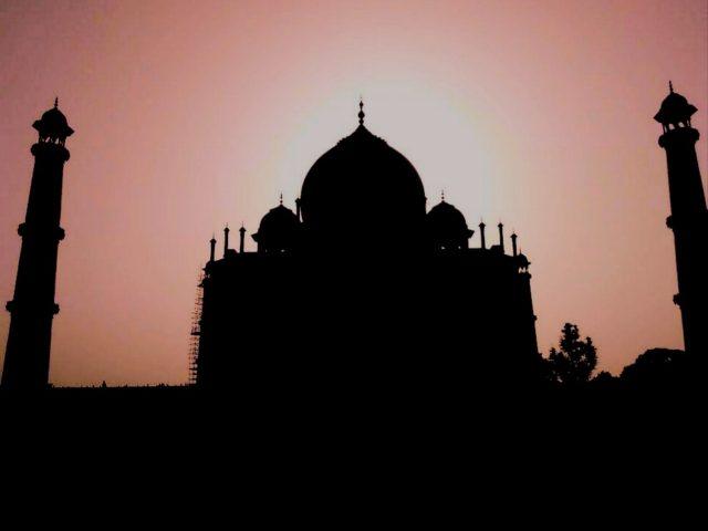 Silhouette of the Taj Mahal during sunset.