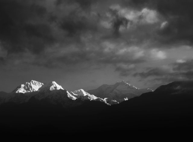 Snow capped mountain ranges.